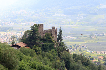 Castle Brunnenburg and Merano cityscape panorama, South Tyrol