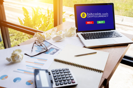 computer tablet with screen for buy or sell bitcoin on workspace table in modern office ,bitcoin electronic money concept.