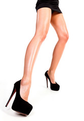Closeup shot of long female legs, white background