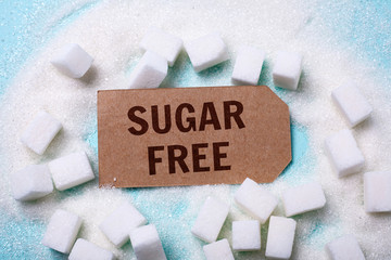 SUGAR FREE words on a green background with a bunch of sugar