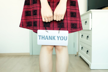 Thank You Message. Female Hand Holding with The Words Thank You in the Room White Studio Background Great for Any Use.