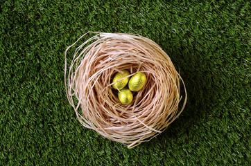 Golden easter eggs in nest