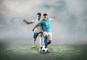 Soccer player on a football field in dynamic action at summer da