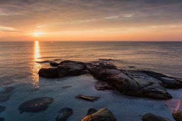 Sea sunrise at the Black Sea coast near Ravda, Bulgaria. Rocky sunrise.