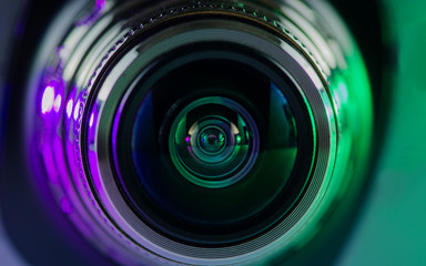 The camera lens and light purple-green.