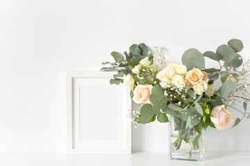 Frame mock up with blush wedding bouquet with roses