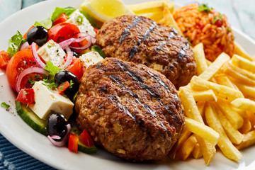 Pan-fired bifteki or frikadelle with Greek salad
