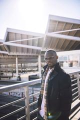 Black confident man on urban background