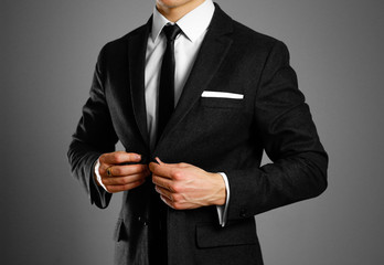 Businessman in a black suit, white shirt and tie. Studio shooting