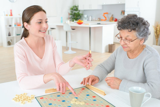 a game of scrabble with an old woman