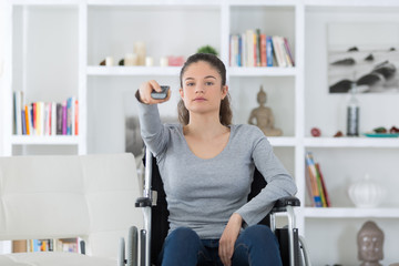 Girl in wheelchair using remote control