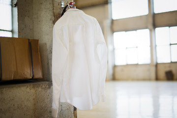 Picture of white shirt hanging in warehouse