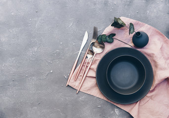 Rustic table setting with vintage ceramic plates and branch on blue old wooden table with copy space