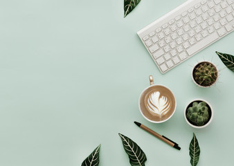 Minimalist Lifestyle For Website, Marketing, Social Media with coffee cup and keyboard. Home office table.