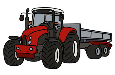 The red heavy tractor with a trailer