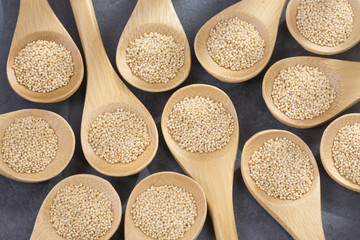 Amaranth seeds in wooden spoons