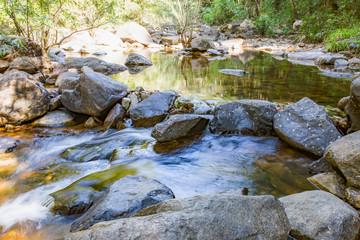 Klong Phlu Waterfall. Mountain spring water, stream between rocks and stones, brook, creek. Thailand, island Koh Chang.