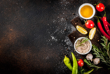 Papiers peints Cuisine Food cooking ingredient, olive oil, herbs and spices, dark rusty background top view copy space