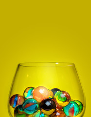 Colorful marbles in glass