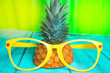 Pineapple with yellow sunglasses