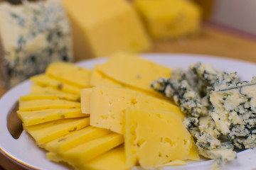 Different kinds of cheese chopped.