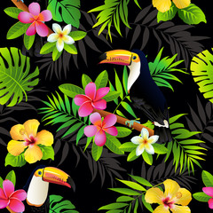 Tropical birds toucans and palm leaves seamless background. Vector.