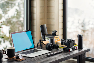 Audio / Video editing workspace office with mountain view. Photography and videography equipment.