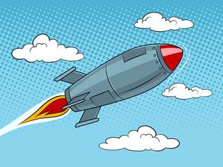 Rocket missile flying pop art style vector