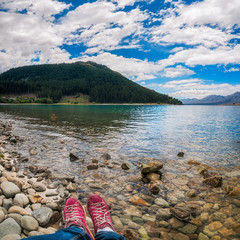 Resting on the shore of Lake Tekapo fringed by the Southern Alps in New Zealand.
