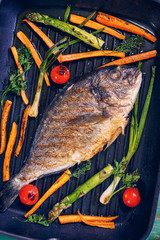 Freshly Baked Sea Bream in a Frying Pan