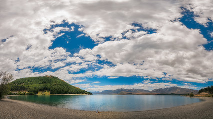 Admire the beautiful Panorama of Lake Tekapo and the Southern Alps in New Zealand.