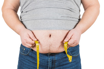 Thick mature man measuring belly yellow measuring tape isolated on white background.