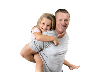 young attractive and happy man carrying his sweet beautiful 7 years old daughter on his back in father and his adorable little girl family love