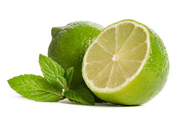 one lime with half of a juicy lime with leaves of mint isolated on white background