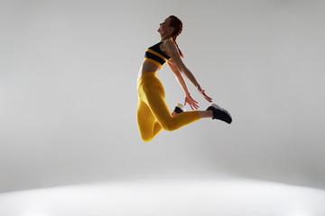 woman in sportswear jumping