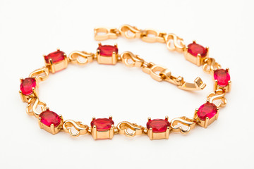 Wall Mural - beautiful photo close-up gold bracelet jewelry, chain, precious stones, diamonds, jewelry