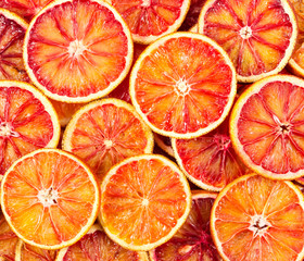 Seamless pattern with red Sicilian oranges.