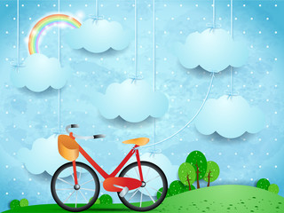 Surreal landscape with hanging clouds and bike