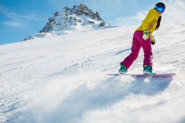 Picture of athlete snowboarding on snow slope