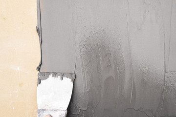 Putty Knife with Spackling Paste to Repair Wall Damage