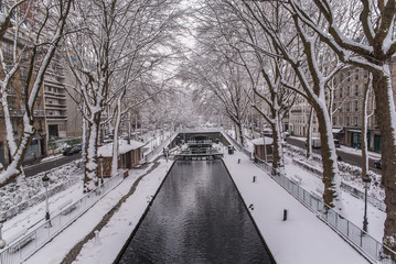 Paris, canal Saint-Martin under the snow, the quay in winter