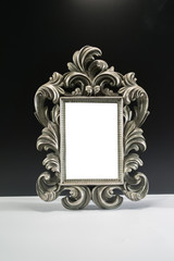 Antique silver metal frame isolated on black and white background
