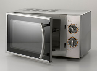 no brand microwave oven in silver. slightly open, on light-grey background