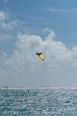 Beach in Guadeloupe, kitesurfer on the ocean, sunset