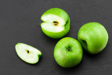 Green apples  on stone table. Top view with copy space