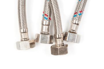 Flexible hoses close up on white background