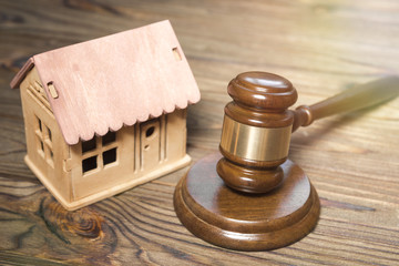wooden hut, judge hammer on a wooden background. housing law. lawyer