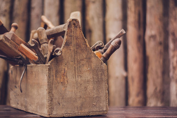 vintage tool box stand on table on wood background