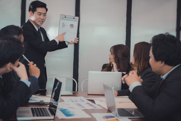 businessman present financial plan report to co worker team. man leader discuss sales data with investor colleagues. finance investment business meeting