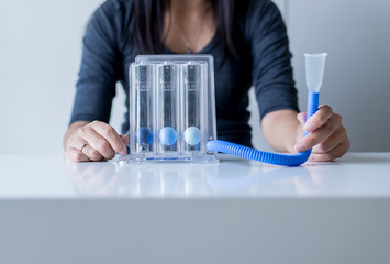 Asian female patients using incentivespirometer or three balls for deep patient breathing